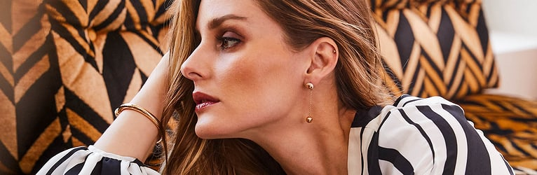 Olivia Palermo wearing gold diamond bangle bracelets and luxury earrings