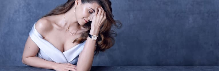 Shiva Safai wearing a gold diamond watch with a rose gold diamond necklace