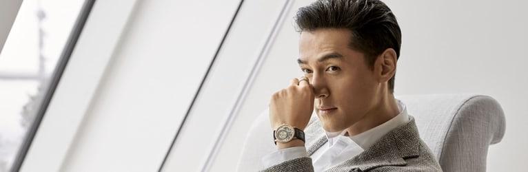 Hu Ge wearing an altiplano rose gold watch for men