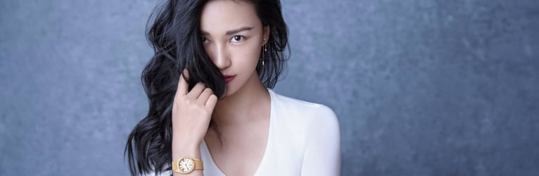 Chen Man matches rose gold diamond earrings with a luxury watch