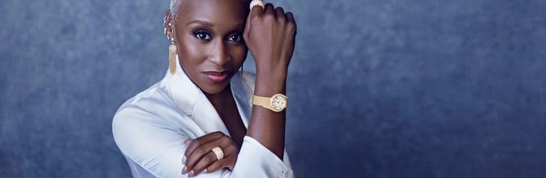 Cynthia Erivo wearing rose gold diamond jewellery and a gold diamond watch