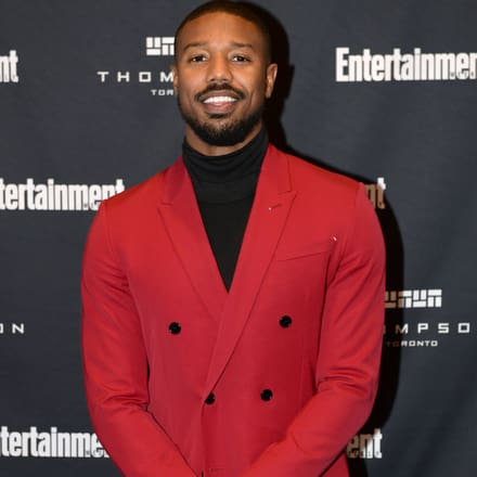 Michael B. Jordan wearing white gold diamond rings and Altiplano ultra-thin watch