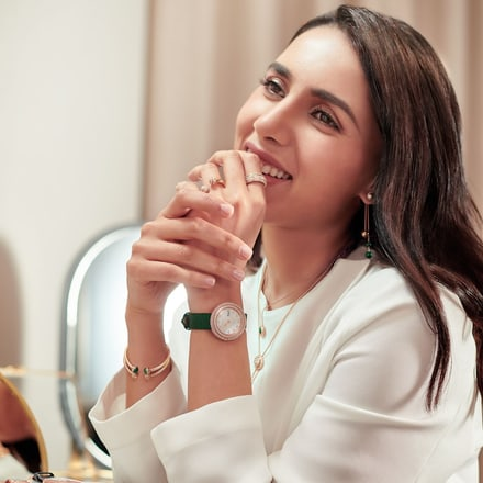 A woman wearing rose gold diamond jewellery for Ramadan