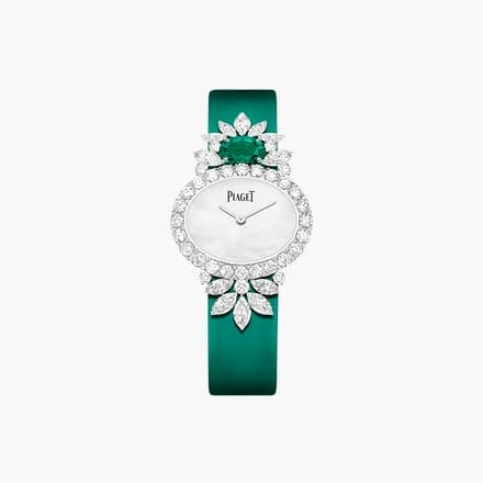 high jewellery watch with diamonds and emeralds