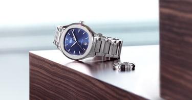 Reloj de lujo de acero para hombre y anillo de oro blanco