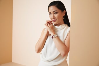 Constance Wu sparkling with luxury jewelry and a rose gold diamond watch