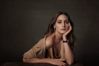 Olivia Palermo stunning with a gold diamond watch and diamond earrings