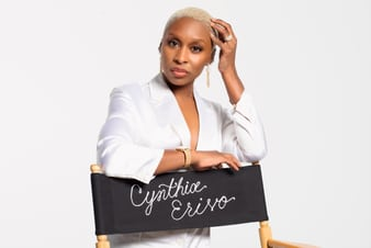Cynthia Erivo sparkling with rose gold diamond earrings and a gold diamond watch