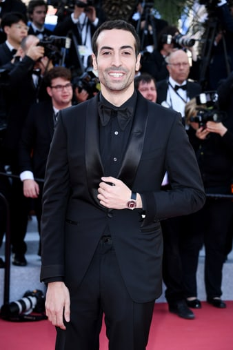 Mohammed Al Turki wearing an iconic Piaget Altiplano high jewellery watch