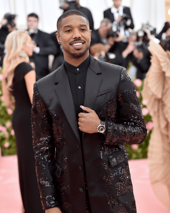 Michael B. Jordan wearing a white gold Altiplano High Jewellery watch