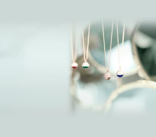 Rose gold and diamond pendants